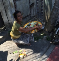 Lady placing offerings