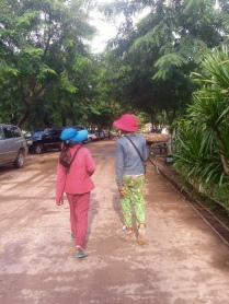 Two girls walking in Siem Reap