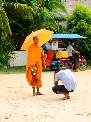 Monk giving a blessing after an offering
