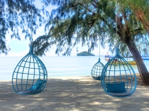 Hanging chairs on the beach