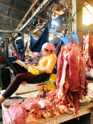 Meat vendor in hammock