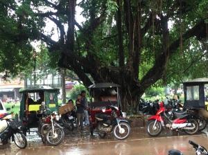 Tuk Tuk drivers waiting in the rain