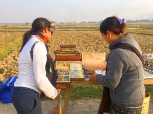 Me buying a Buddha astrology scroll