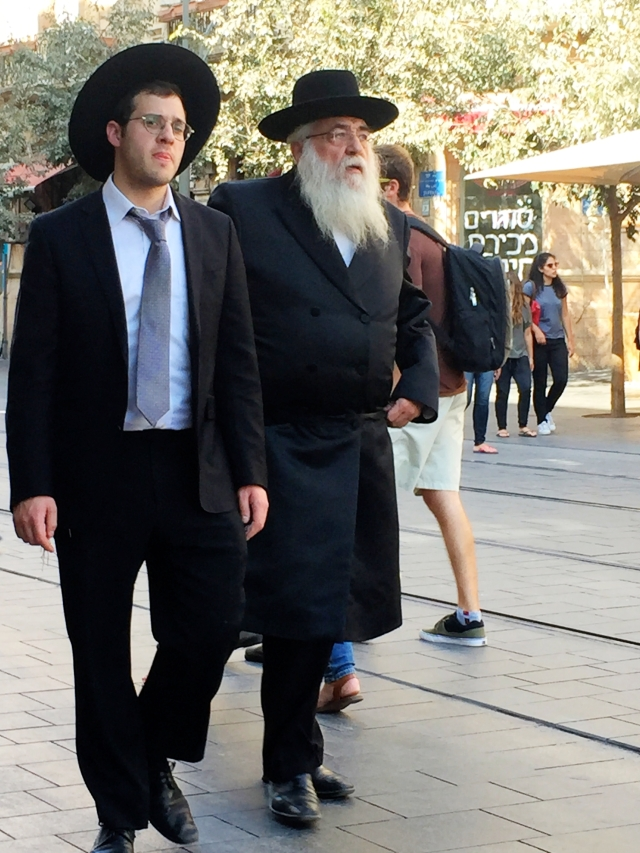 Haredi Jewish men wearing black formal Homburg hats