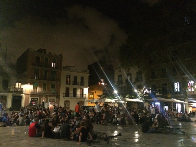 People sitting in the placa on Thursday evening at 11:30pm