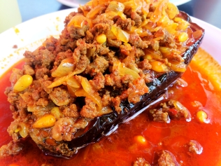 Eggplant stuffed with ground beef and pine nuts in a cinnamon sauce