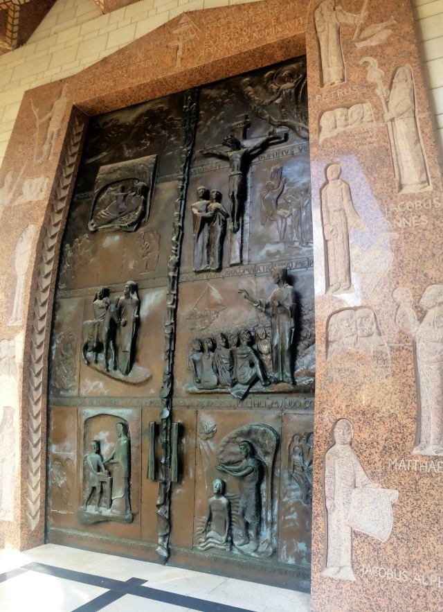 The story of Jesus engraved in the door of the church.