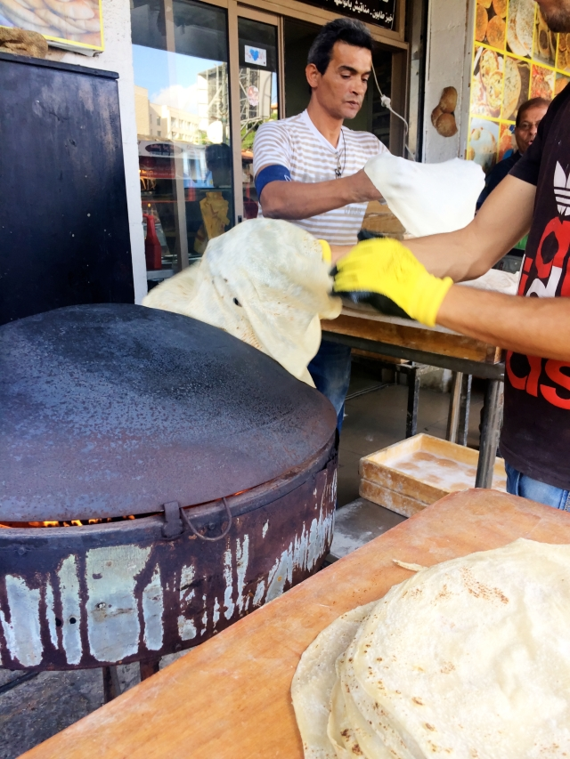 Making laffa (a thick, flat bread wrap that is larger than a regular pita)