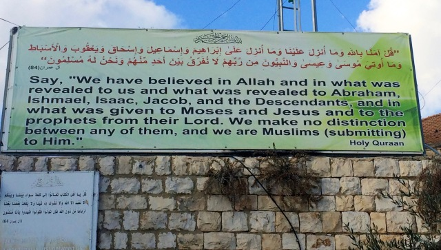 Muslim billboard by the church