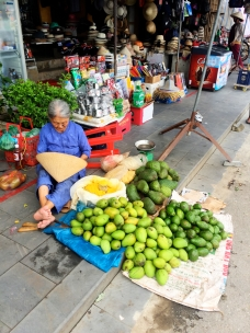 Lady selling fresh vegetables curbside