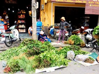 Ladies selling fresh herbs curbside