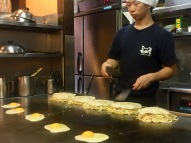 Cooking Okonomiyaki at Okonomiyaki Nagataya